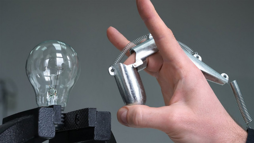 This Metal Finger Machine's Flick Can Shatter a Light Bulb