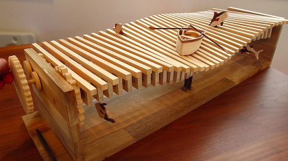 Man Builds Mesmerizing Hand-Cranked Wooden Kinetic Wave Sculpture