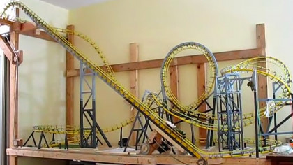 Hobbyist Tries Out 13-Car Train on Mini Roller Coaster