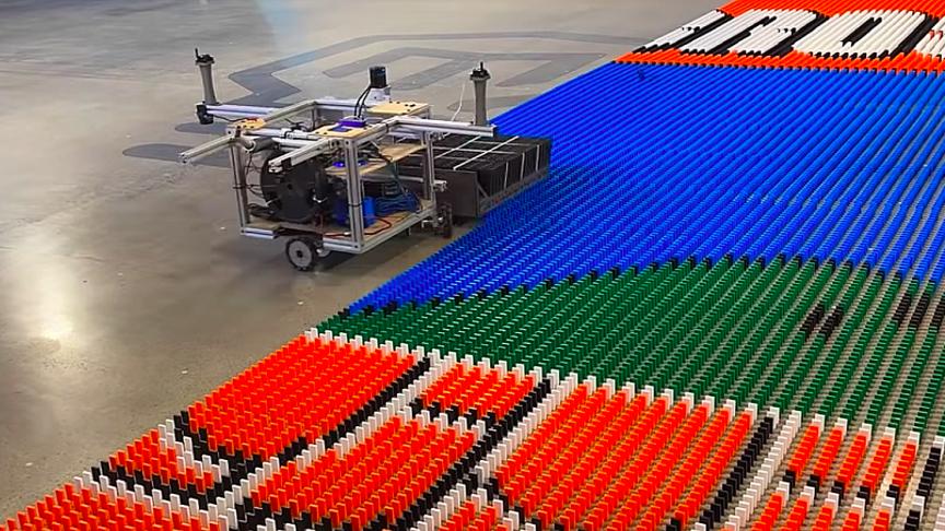 Ex-NASA Engineer Builds Record-Breaking Domino Robot In Five Years