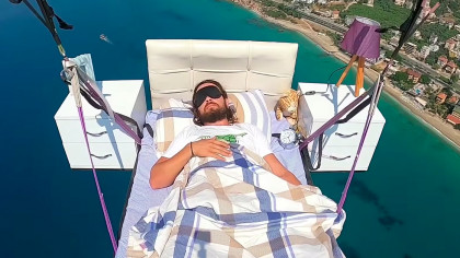 Paraglider Sleeps on a Bed While Flying Over the Mediterranean Sea