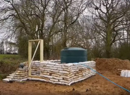 Watch This Video and Learn How To Build Your Very Own Cabin Using Mostly Bags Filled with Earth