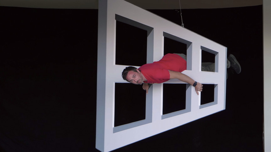 YouTuber Turns Himself Into an Illusion by Going Through Window